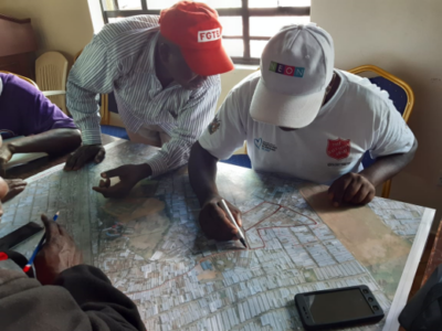 Men in Mukuru during CHV mapping exercise